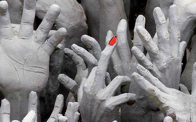 White hands arise from the underworld, with a different meaning for Buddhism and animism.
