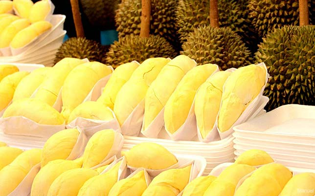 Durian stall in a market, a famous and controversial tropical fruit.