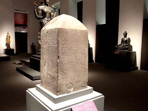 Milestone with scription in the National Museum.