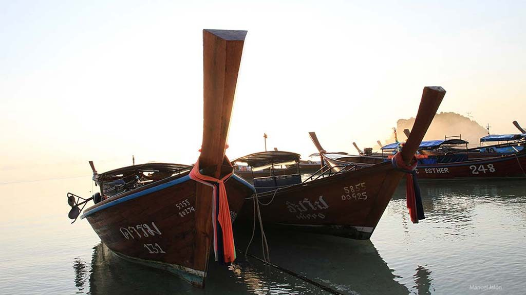 Longtail boats on the shore of the beach.