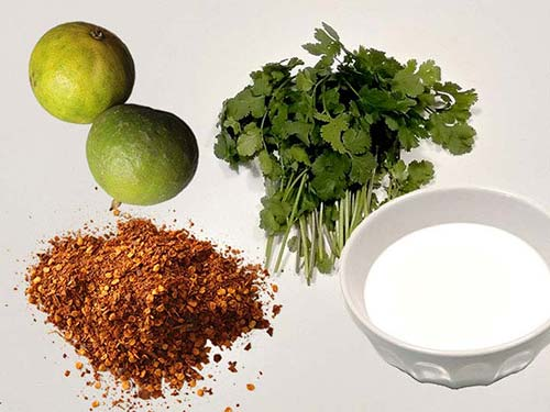 Ingredients of the Tom Ka Gai coconut milk chicken soup: Coriander, chilli, coconut milk and lime.