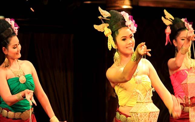 Girls dancing traditional Thai dance.